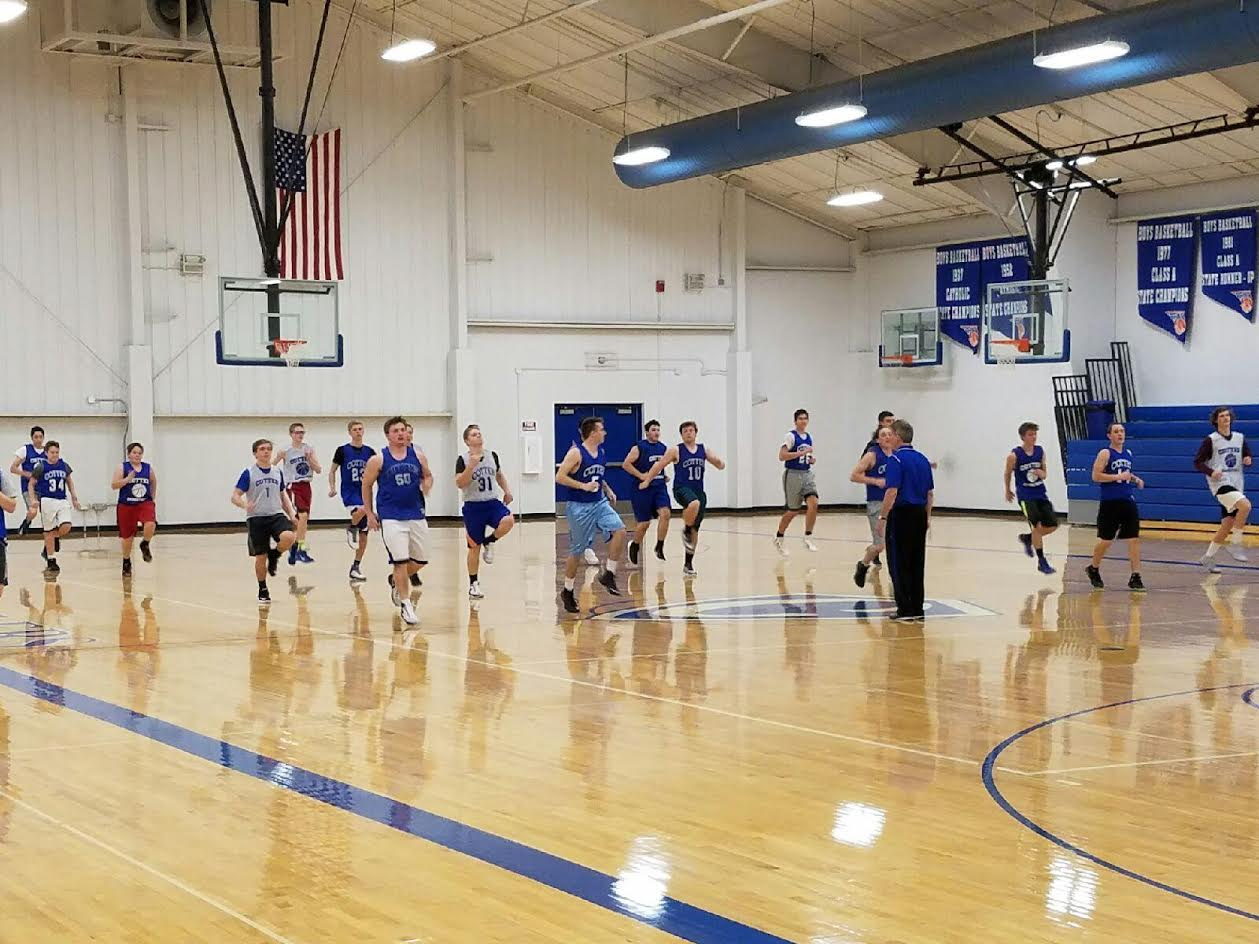 Cotter chronicle boys basketball focus on effort and for How much to build a basketball gym