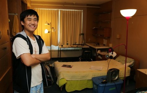 David Moon - A senior this year, stands in front of his sparkling clean room.