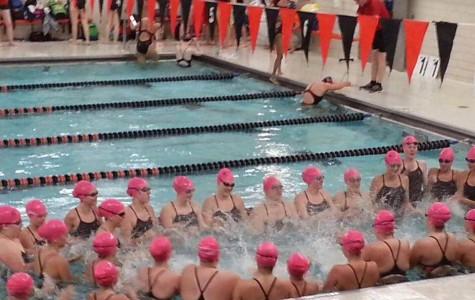 The WSH swim team warms up with Cotter students.