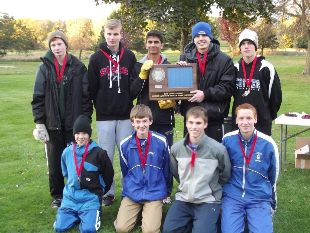 The Cotter Boy's Cross Country team poses with their awards