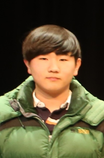 Sang-Hyuk Lee poses for the camera during the Cotter Math Team state sendoff.