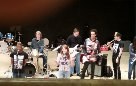 The McNally Smith SKA ensemble hangs out on stage before performing.