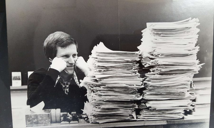 Mr. Miller contemplating a stack of essays at WSHS