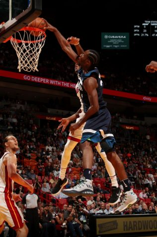 Wolves hold off Heat in OT to move over .500