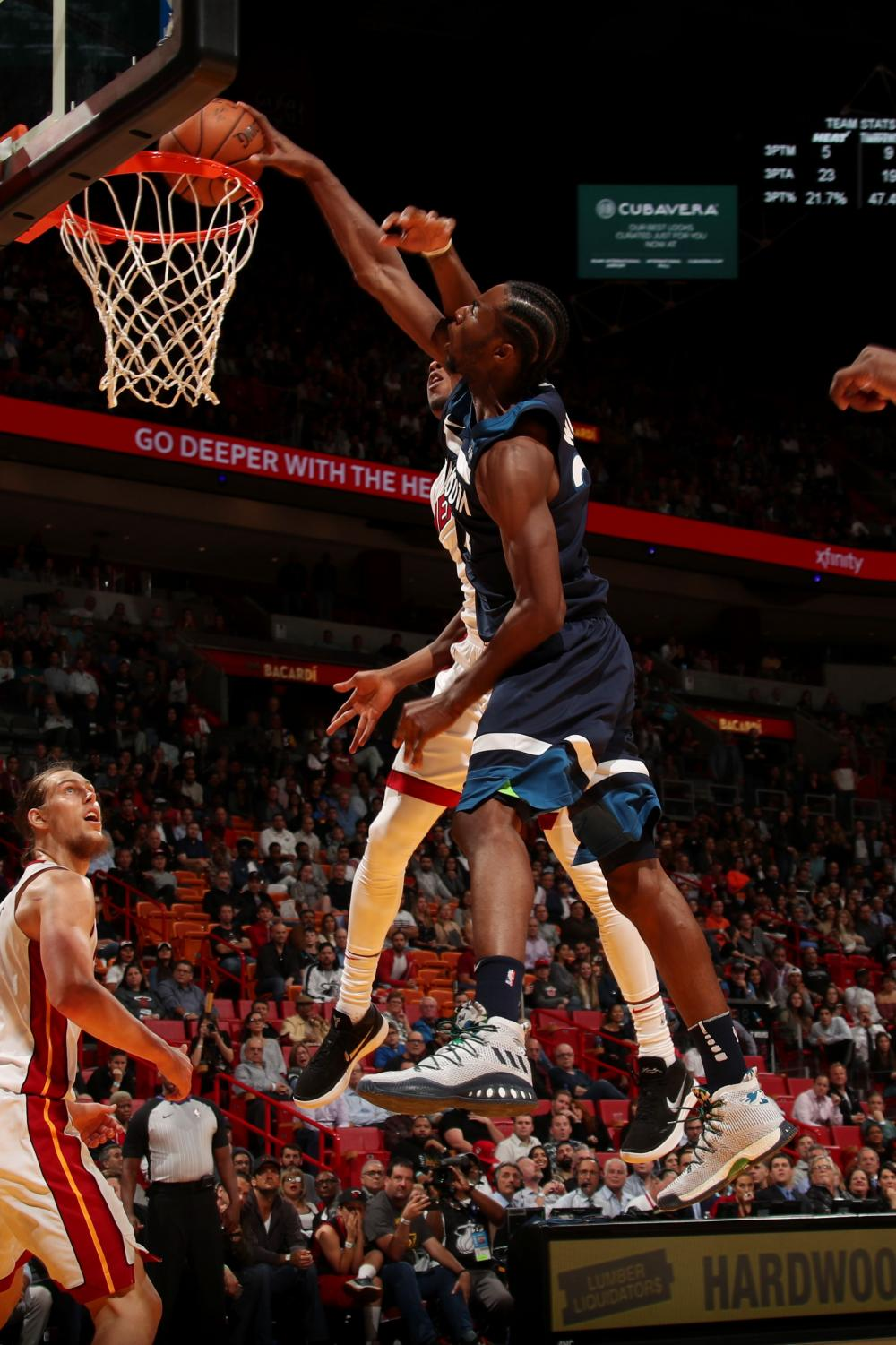 Wolves guard Andrew Wiggins dunks on Miami's Josh Richardson. (Issac Baldizon/NBAE/Getty Images)