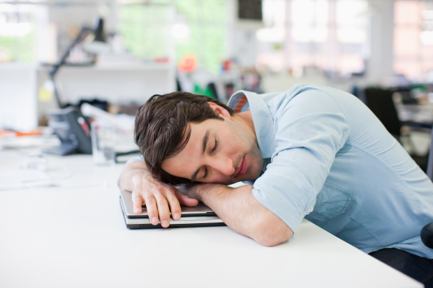 Businessman+sleeping+on+laptop+at+desk+in+office