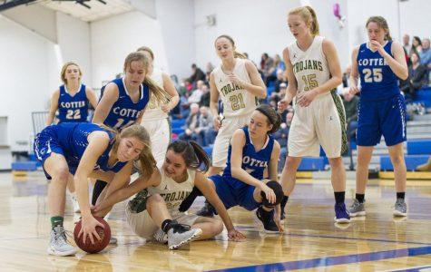 Olivia Gardner battles for a loose ball vs R-P.  photo by Chuck Miller, Winona Daily News