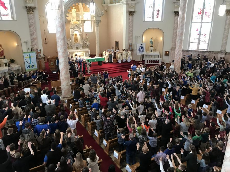 Fr. Jim Berning receives an ovation at CSW mass at St. Stan's on Feb. 1.  This was Fr. Jim's last mass with WACS and Cotter