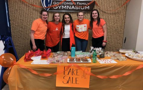Girls basketball team raises $1000 for cotter family