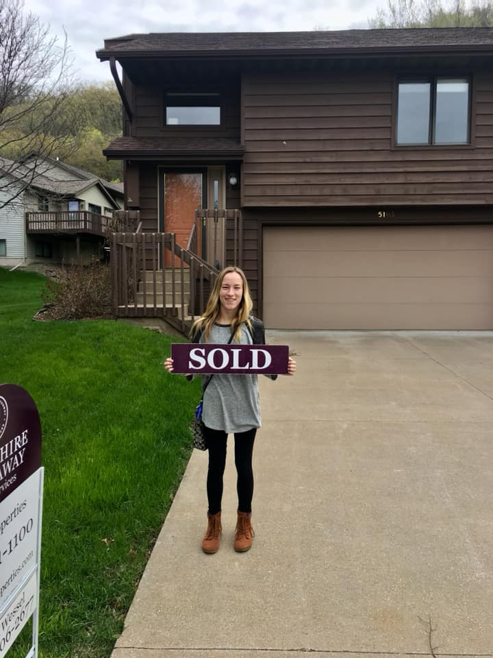 Alum, Chloe Trainor in front of new house