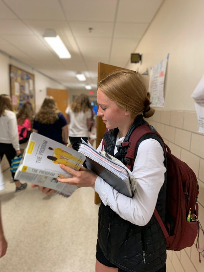 Maren Stewart reading her lit circle book in between classes.  Like many students, Stewart is juggling lots of activities