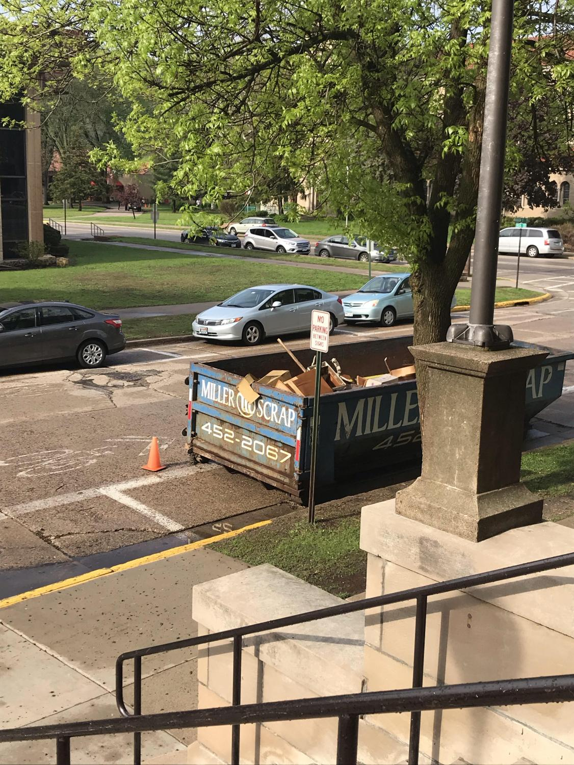 Dumpster outside the high school. Teachers making room for everyone in one building.