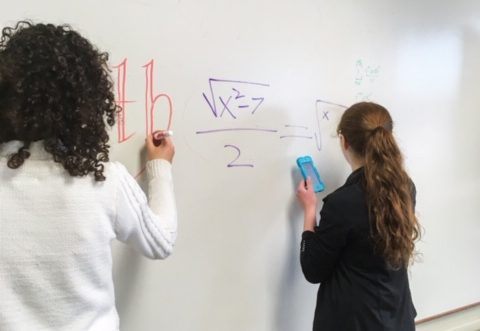 Cotter math team students at work at the board