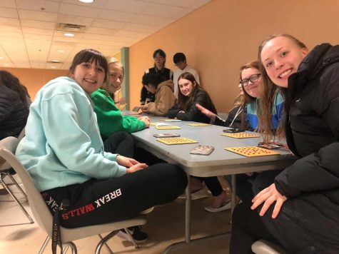 Ceili DeMarais, Rita Row, Tony Wan, Jesse Liang, Angela Zhen, Aubrey Williams, Trinity Schmidtknecht, Macey Dvorak, Jprdan Rubie at the Bingo tables.