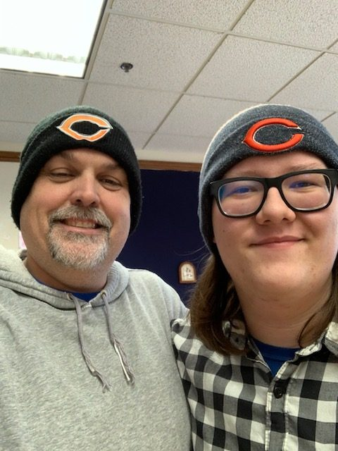 Mr. McGlaun and Sal Piscitiello sport Chicago Bears hats for theme day.