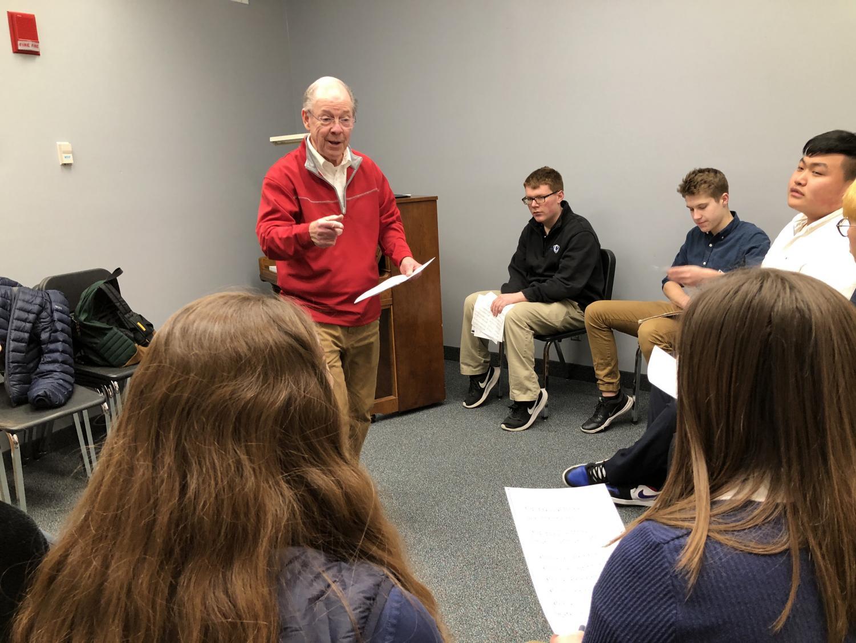 Jim Ballard mentoring Choir students in preparation for All Schools' Mass
