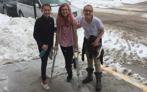 Macy Piechowski, and Ava Koopman help Zayda King-Henke get back to classes after spraining an ankle in PE