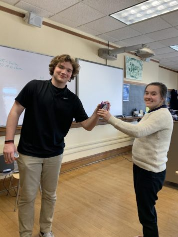Charlie Reilly delivers a can of Crush to Fiona Flanagan as part of the National Honor Society