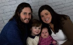 Mrs. Klick is pictured here with her husband Brian and her 2 children, Cormac and Margaret.