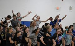 The eighth grade teams gather together to cheer against the seventh graders.
