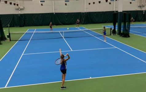 Katelyn Ubl and Olivia Moore compete against Cannon Falls.
