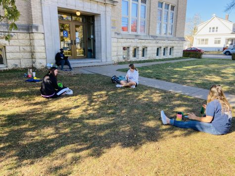 Mary Hansel-Parlin, Ellie Glodowski, Grace Menke, and Alison French meet outside of the Cummings St. entrance to enjoy the weather, knit, and talk.