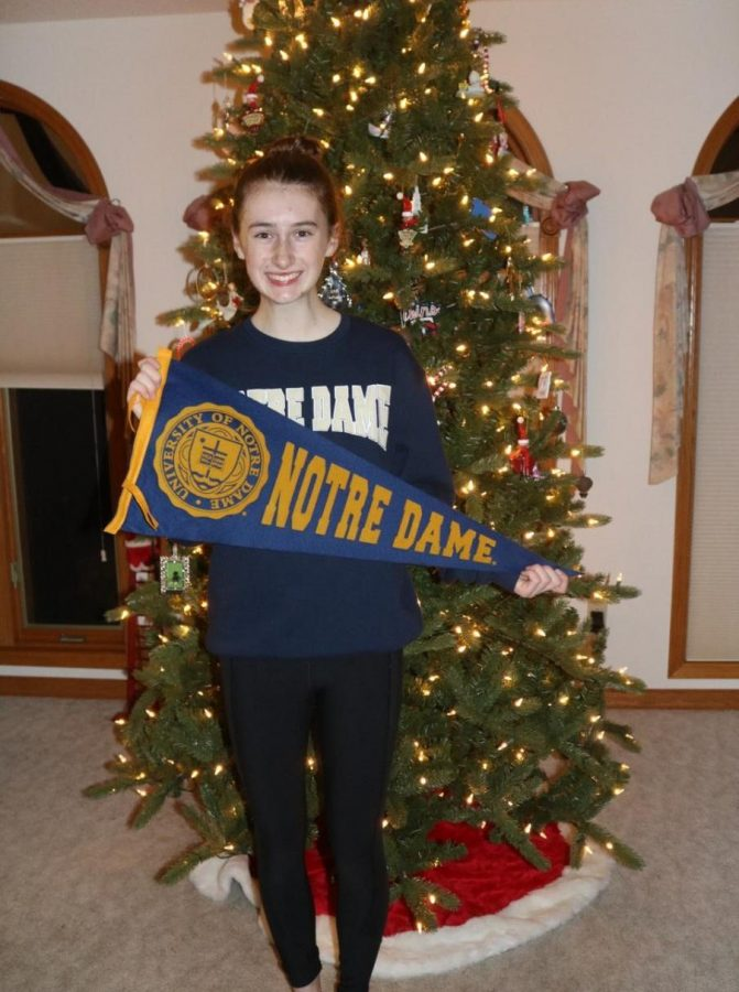 Aubrey Williams poses with her Notre Dame flag. Credit: Linda Williams.