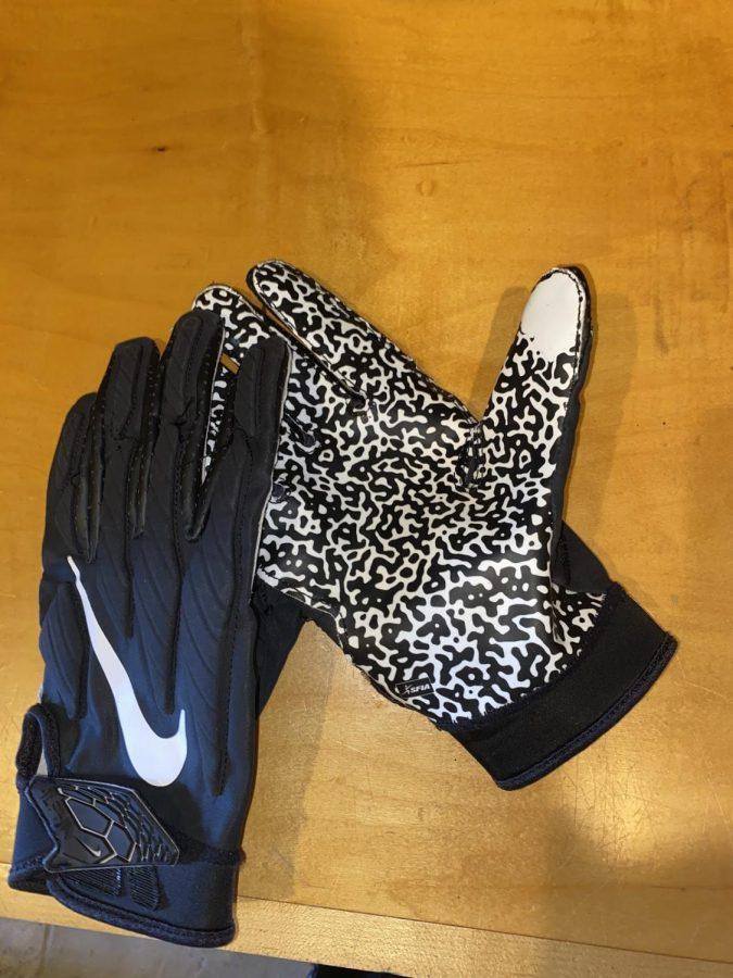 A+broken+in+pair+of+Nike%27s+Superbad+football+gloves
