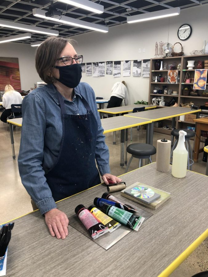 Mrs. Forney prepares for high school students to return to in-person art classes in John Nett's newly renovated art room.