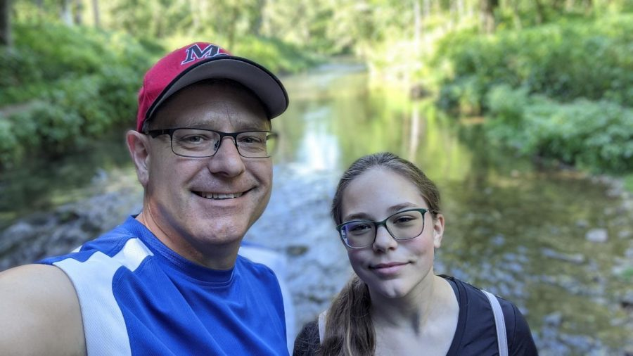 Father and daughter out enjoying nature.