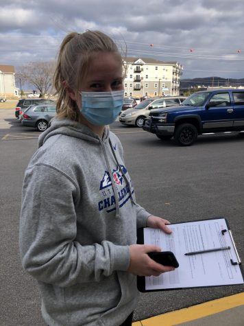 Cotter student Freya Brandvik waits in line at Winona Health to receive the Covid-19 vaccine