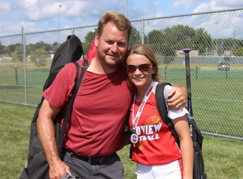 Shawn and Maddie Kohner share a moment together after a summer softball tournament.