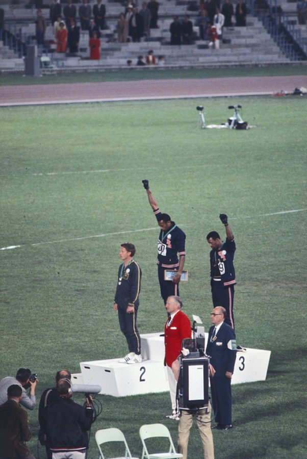 Tommie Smith and John Carlos protesting poverty and racial injustice at the 1968 Olympic Games. Photo via Wikimedia Commons under Creative Commons license