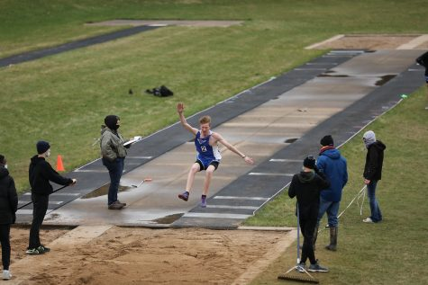 Cole Ebertowski competes in the high jump at the first track meet of the season in St. Charles