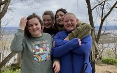 Juniors Suzanne Duellman, Abby Briggs, Grace Menke, and Abby Allred (left to right) spend quality time high in the bluffs of Winona County.