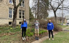 AP Physics students, Grace Menke, Cale Beckman, and Maren Stewart take a walk outside the Cotter building on April 9.