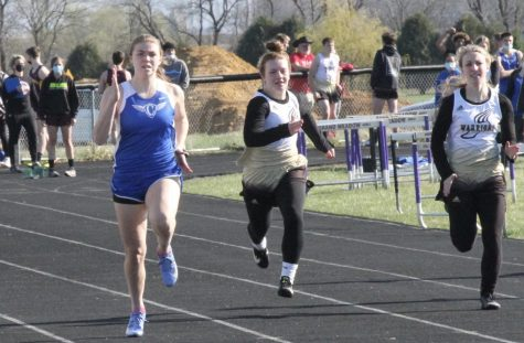 Olivia Gardner runs the 100 meter dash.  Gardner set a school record with a time of 12.72