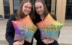 Grace Miller and Aubrey Williams, Cotter's two State speech champions, celebrate making finals, prior to earning their ultimate titles.
