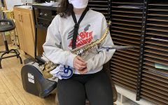 Alessia sits in the band room before marching band Wednesday evening.