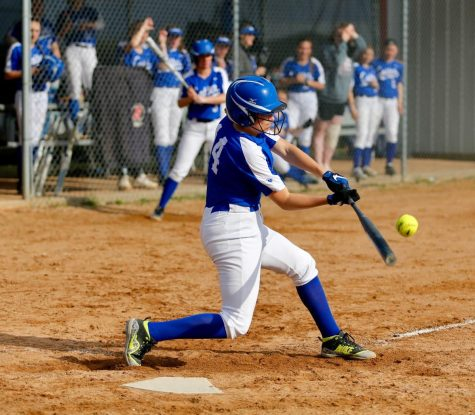 Ellie Macal swings at a pitch in Cotter