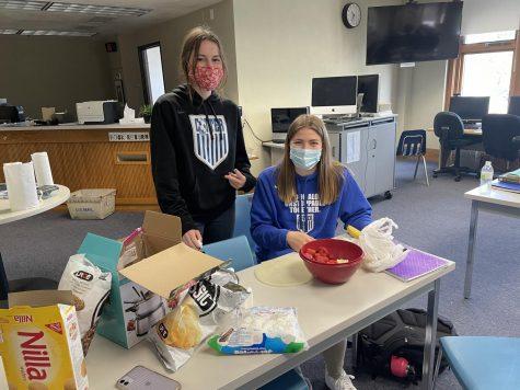Sera Speltz (left)and Olivia Gardner (right) enjoy Fondue Friday in study hall