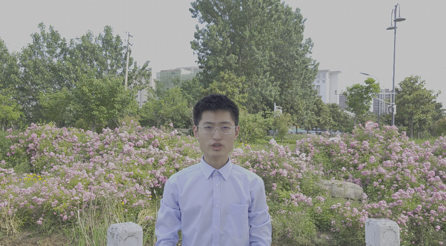 The reporter in a park near his home autorecording a petition for the graduation ceremony