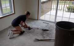 Alli Benson tears up a floor at a residential project working with her father