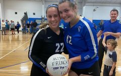 Ali French (L) poses with her 100th dig ball next to fellow senior Olivia Blumers (R)