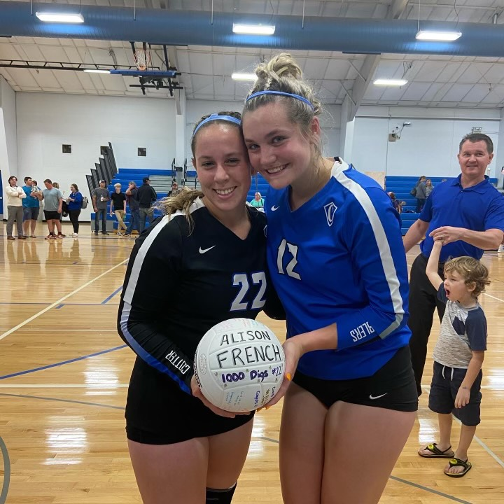 Ali+French+%28L%29+poses+with+her+100th+dig+ball+next+to+fellow+senior+Olivia+Blumers+%28R%29