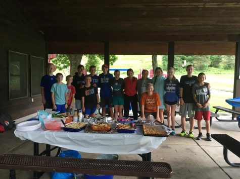 Cross Country members enjoy a team dinner at the Valley Oaks Park Pavilion.