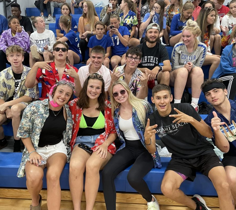 The+Cotter+student+section%2C+the+6th+man+megacorps%2C+enjoy+themselves+at+the+home+opener+volleyball+match