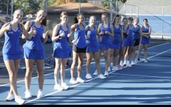 The Cotter tennis poses at a home meet.  The team looks to  lean on many returning players next season.