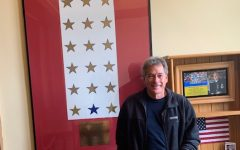 Jim Crigler stands in front of the Gold Star families display in St. Teresa Hall at Cotter High School.